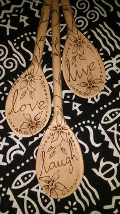Pyrography, three graduated wooden spoons.