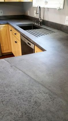 33 Amazing and Stylist Kitchen Decor Countertops Ideas on Budget - Interesting use of seams in this medium grey concrete countertop - Outdoor Kitchen Countertops, Grey Countertops, Kitchen Countertop Materials, Concrete Counter Tops Kitchen, Types Of Countertops, Outdoor Kitchen Design, Rustic Kitchen, Diy Kitchen, Kitchen Ideas