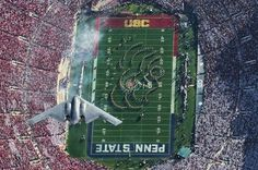 AMAZING LOOK DOWN SHOT OF B-2 BOMBER FLY BY OVER USC PENN STATE FOOTBALL STADIUM