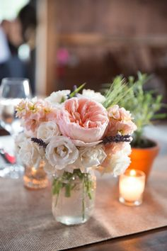 Pink and peach centerpiece | Rustic & Modern Maine Wedding via TheELD.com