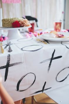 Here's how to make your own XOXO painted tablecloth. Photo by Brooke Courtney Photography via Walk in Love