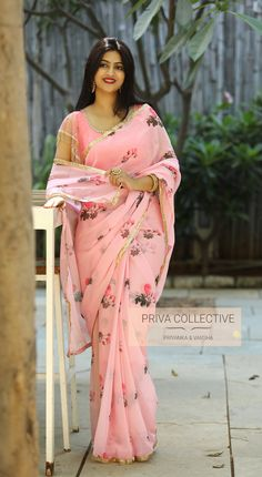 PV 4044 : Pink Floral Price : 3800 RsBring in this beautiful pink floral georgette sari finished with gold borderUnstitched blouse piece : Pink silk for body and sequins net fabric for sleeves as displayed in the pictureFor Order 25 March 2019 Simple Sarees, Trendy Sarees, Fancy Sarees, Floral Print Sarees, Printed Sarees, Saree Blouse Patterns, Saree Blouse Designs, Indian Beauty Saree, Indian Sarees