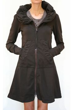 Prairie Underground Cloak Hoodie.  Love the feminine lines of this.  Great for travel days..  This store has a great selection.  http://www.warmthcompany.com/