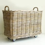 Just add a simple frame of 1x4's and attach wheels to that frame then sit the basket atop. Attach the basket if you feel it necessary with bolts and washers. So many uses in so many rooms!