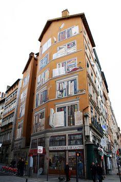 This beautiful fresco adorns the exterior of the La Bibliotèque De La Cité (Library of the City) in Lyon, France.