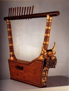 """Great Lyre"" with bull's head and inlaid front panel, ca. 2550–2400 B.C.; Early Dynastic IIIA. Mesopotamia, Ur, PG 789, King's Grave, U.10556. Gold, silver, lapis lazuli, shell, bitumen, and wood; H. of head 35.6 cm (14 in.); H. of plaque 33 cm (13 in.); max. L. of lyre 140 cm (55 1/8 in.); H. of upright back arm 117 cm (46 1/8 in.). University of Pennsylvania Museum of Archaeology and Anthropology, Philadelphia."