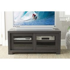 This unusual dark gray sliding door media cabinet will blend beautifully with modernist decor. The multiple storage sections mean that you can stash all of your clutter and peripherals, creating a smooth and elegant look for your living space.