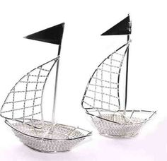 Hey, I found this really awesome Etsy listing at http://www.etsy.com/listing/88228036/sailboat-nautical-wedding-favors