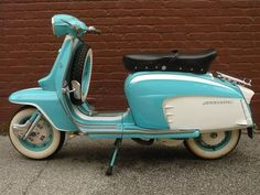 Vintage Vespa - I would sell my car in a heart beat of this became mine :]