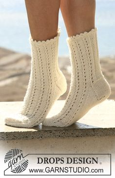 """DROPS socks in lace pattern with crochet picot border in """"Fabel. ~ DROPS Design"""