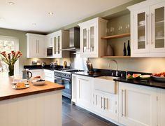 White cabinets, sage walls and grey floor