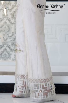 Ivory raw silk boot cut trousers with pink crystal embroidery and embellishment. Please note these are trousers only. Please note delivery time is approximatel Fashion Pants, Boho Fashion, Fashion Dresses, Mehndi Fashion, Eid Outfits, Pakistani Outfits, Silk Pants, Trouser Pants, Khadi Kurta