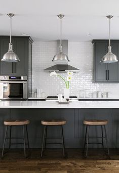 Interior Design Kitchen black, white, grey, wood kitchen with oversized kitchen island // anne sage - Get sustainable kitchen design ideas from Cambria quartz countertops, which are manufactured in the USA at a plant that recycles of its water! Home Decor Kitchen, New Kitchen, Kitchen Wood, Kitchen White, Sage Kitchen, Kitchen Ideas, Black And Grey Kitchen, Black Kitchen Island, Kitchen Colors