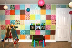 scrapbook paper wall... great for rental spaces that you can't paint... but dont wanna leave plain ... yes please!!!!