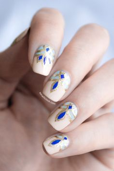 Forget red + gold. This blue + gold mani is the epitome of festive.