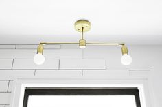 Instructions and Parts list for minimalist DIY Double Brass Pendant