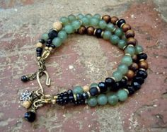 This three strand, free-spirited, bracelet combines czech beads in a bright red tone & matte golden with small seed beads in a golden shimmer, deep red enameled beads with intricate flower detail. A few pretty bead charms complete this adjustable boho chic bracelet.  A absolute gorgeous multi strand bracelet !  Sure to please your gypsy soul