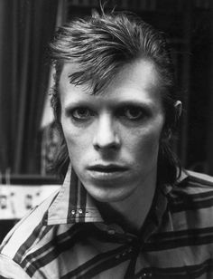 The British legend wrote songs above all about being an outsider: an alien, a misfit, a sexual adventurer, a faraway astronaut.