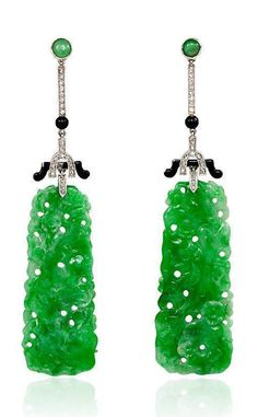 A pair of Art Deco jade, diamond and black enamel earrings, with carved jade floral panels, in platinum.  	      	  Circa:  	  1930