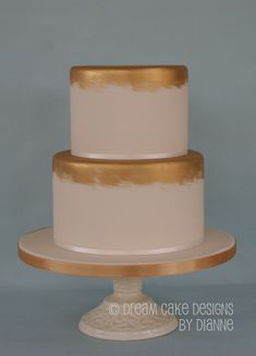 Chocolate sponge with chocolate and caramel buttercream and lemon curd. Both tiers covered with a layer of white chocolate ganache and ivory sugarpaste which was loosely painted with a blend of 3 colours of edible gold lustre to match the satin ribbon. White Chocolate Ganache, Chocolate Sponge, 3 Tier Wedding Cakes, Caramel Buttercream, Small Intimate Wedding, Dream Cake, Lemon Curd, Celebration Cakes, Cake Designs