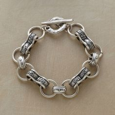 AVALON BRACELET�--�Vine bedecked double links and dot bedaubed single links impart a medieval sensibility to our handcrafted bracelet. In matte silver-plated pewter with a toggle clasp. Approx. 8L.