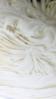 The BEST Cream Cheese Frosting ~ This frosting is stiff, sturdy, pipe-able, spreadable and it's not overly sweet. The big difference between this recipe and all those other ones, is that this recipe uses more butter and less powdered sugar.: