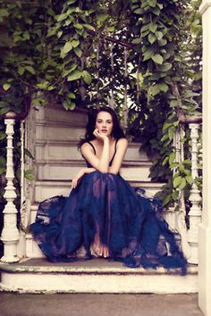 girl on an old staircase with blue dress. photoshoot idea