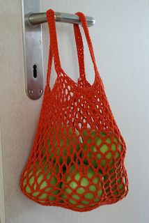 """""""I designed this bag for utilitarian purposes with myself, my friends & family in mind. It is a sturdy, medium sized mesh bag that will be large enough to replace a regular size plastic bag from the grocery store. It comes out looking small but it holds a mighty load. It is designed to be just the right size to hold heavy groceries (like 4 heavy cans) without hitting the ground or falling out. They are also just the right size to avoid overloading and making the bag uncomfortably heavy…"""