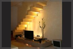 creative way to highlight the staircase - 10 easy tips to light up your home