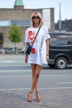 Copenhagen Fashion Week Spring 2015, street style. Oversized tee and heels. Image via Harper's BAZAAR