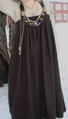 Lovely apron dress based upon the Kostrup find but with a wider pleated portion than is consistent with the actual find.  Note the absence of a tablet-woven band over the top of the pleats.