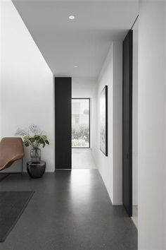Grey toned interior with black sliding doors by Daskal Laperre. Photography by Karel van Overberghe.
