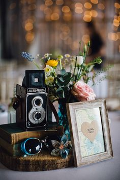 Vintage Table Plans with Antique looks and cameras   Travel Theme Decor   Vintage Maps   Rustic Barn Reception   Spring Wedding   Image by Samuel Docker Photography   http://www.rockmywedding.co.uk/lorna-george/