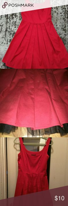 Pinup red dress with tulle Red dress with black tulle at the bottom that makes it look like there is a petticoat underneath. Adorable! Zips on the side. Fits a small/medium B. Darlin  Dresses