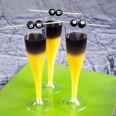 "Gigi Martini  BOO:GOBLIN MIMOSASIngredients5 oz. orange juice1 oz. black vodkaBlueberriesCandy eyeballsPreparationFill glass halfway with orange juice. Pour black vodka carefully over juice to layer. Top glasses with skewered ""eyeballs"" by placing candy eyeballs inside blueberries."