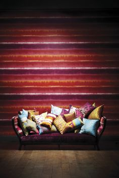 This statement water colour striped wallpaper demeter stripe is from Harlequin's Kallianthi collection.