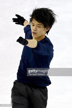Takahiko Kozuka of Japan in action during a practice session ahead of the ISU World Figure Skating Championships at Shanghai Oriental Sports Center on March 24, 2015 in Shanghai, China.