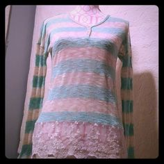 Super cute top Long sleeve sheer top. Beautiful lace all along the bottom. In excellent condition. Soft teal green and cream color Daytrip Tops
