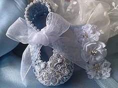 Blue with Pearls and Lace Crochet Booties and Matching Headband      Very elegant with a vintage feel these dainty, light blue booties are