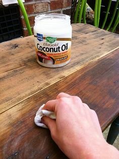 Refinish old dry wood: simply sand and wash with warm soapy water. After washing, let the wood dry out. Use a clean dry rag, apply thin coat of coconut oil. Let it sit for 5 minutes or so, and then buff (wipe in a circular motion). Repeat if the wood is really dry. Can also apply a coat of Miss Mustard Seed Furniture Wax as added protection. The coconut oil brings out the natural color of the wood, re-hydrates the wood, and takes away that old musty barn smell.