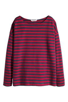 Bawełniana bluza w paski: Bluza z grubego bawełnianego dżerseju w paski. Prosty krój, obniżone ramiona i długi rękaw. Nieco szerszy dekolt.