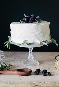 Coconut cake; key lime frosting filling; blackberry buttercream + garnish