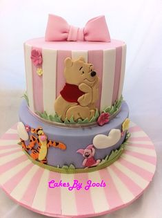 Simply adorable pink Winnie the Pooh cake! Perfect for a Disney baby shower or 1st birthday party.