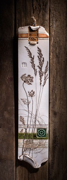 Botanical pieces have been pressed into the wet clay to create the elegant look of those wall plaques.Varied textures and vibrant colors make them an exquisite piece of the home decor.