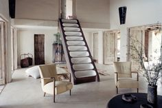 Consuelo Castiglioni's family home in Formentera, Spain epitomizes less-is-more elegance through the use of creamy, bohemian-inflected furnishings and decor.