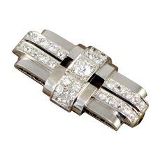 "DUSAUSOY Paris Art Deco Diamond Brooch.Platinum and Diamond ""Machine Age"" Bar Brooch,32 diamonds 3.50 caratscenter diamond 0.75. France 1930s"