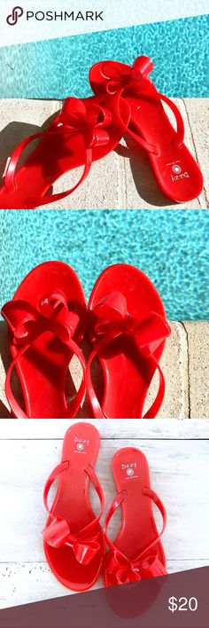Red Dizzy Oversized Bow Jelly Flip Flop Sandals 8 Dizzy jelly flip flops / thong sandals with oversized bows. Color is red. These are awesome, awesome poolside shoes that look amazing with a kimono coverup.  * EUC, lightly worn, only some wear on the outer soles which can probably be cleaned off.  * Marks size EU 40, but a true size 8  ♡20% off bundles of 2+ ♡Check out my other goodies! Dizzy Shoes Sandals