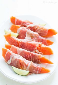 Papaya, Prosciutto, and Lime ~ Slices of fresh papaya served with thinly sliced prosciutto and fresh squeezed lime. ~ SimplyRecipes.com