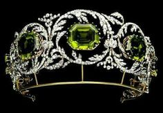 301 Archduchess Isabella's Peridot and Diamond Tiara: These particular peridots are quite fine with good purity huge size and a deep olive color. There are five peridot stones in the tiara each surrounded by a scrolling foliate diamond frame. The tiara is Royal Crowns, Royal Tiaras, Tiaras And Crowns, Royal Jewelry, Fine Jewelry, Antique Jewelry, Vintage Jewelry, Diamond Tiara, Family Jewels