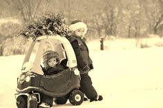 Funny Christmas Card - Kids in Cozy Coupe with Christmas Tree on Top